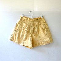 90s yellow shorts. high waisted shorts. preppy pleated shorts.