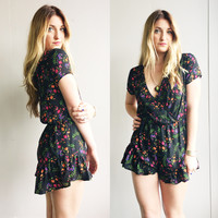 A Floral Print Romper in Black