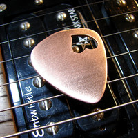 copper guitar pick with heart cut out