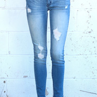 Distressed Light Wash Skinny Jean