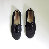vintage 80s all black canvas tennis shoes. lace up black shoes. hipster shoes.