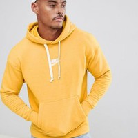 Nike Heritage Pullover Hoodie In Yellow 928437-752 at asos.com