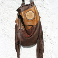 Fringe fringed brown free people with gypsy soul boho bohemian festival leather oversized big wood slice handmade lucky bag distressed