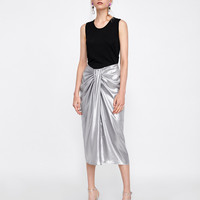METALLIC-LOOK DRAPED SKIRT DETAILS