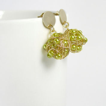 Wire wrapped lime green dangle earrings/ green pearlescent glass fire ball