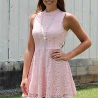 sleeveless dress with high neck and cut out back