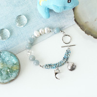 Ocean Inspired Arm Candy made of Light Blue Aquamarine, Freshwater Pearls and Dolphin Charm