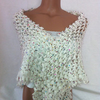 Crocheted white color shawl with shiny colorful spangles