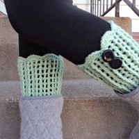 mint leg warmer with two black buttons