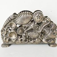 1994 silver godinger, napkin holder, sea bottom, table decoration, silver table service, seashell art,