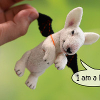 Needle felted Haloween english bull terrier. Cute tiny animal. Funny white bull terrier with a bat wings.