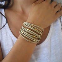 Beige cotton cord with gold plated tube beads - 3X wrap bracelet