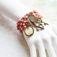 DELICATE ROSE 5pcs. Bracelets made of brass and natural coral with pendants