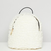 ASOS DESIGN mini shearling backpack at asos.com