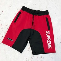 Supreme street fashion men and women color matching couples casual sports shorts Red