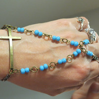 """Beaded Cross """"Slave Bracelet"""" Ring. Religious Christian, Catholic Bracelet with baby blue beads. Adjustable. Fits wrists 6 to 8 inches."""