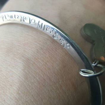 Hand stamped stainless steel bangle