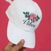 VIBES strap back