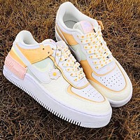 Air force AF1 NIKE macaron cream embroidery, laser vents on the upper, chrysanthemum pendant beige