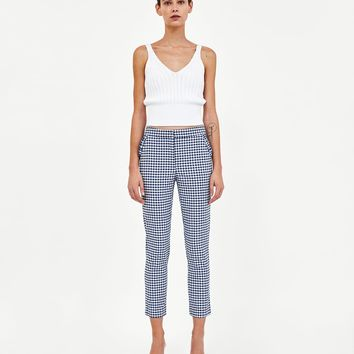 CHECKED TROUSERS WITH RUFFLES DETAILS