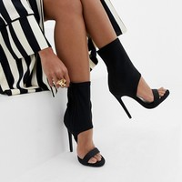 Simmi London black cut out heeled sock boots at asos.com
