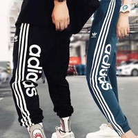 Adidas Fashion New Letter Leaf Print Women Men Sports Leisure Pants