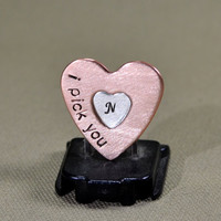 Copper heart shaped guitar pick with silver heart