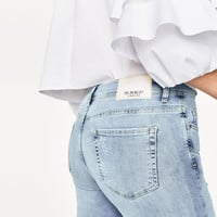 RIPPED MID-RISE JEANS