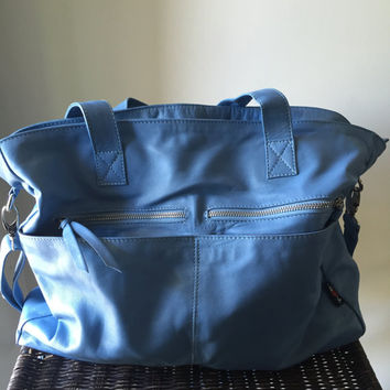 Large, leather tote, generous handbag.Perfect shoulder bag,slouchy design with lots of compartments and pockets .Great laptop work bag,lined