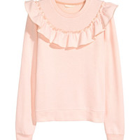 H&M Sweatshirt with Ruffle $24.99