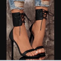 The new snakeskin print high-heel, open-toe lacing shoes are hot sellers