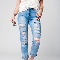 Denim jeans with extreme rips and paint splatter